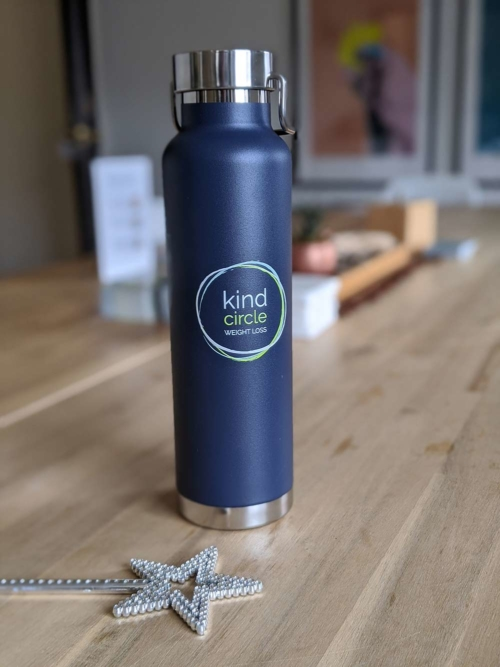 Kind Circle Weight Wellness clinic logo on water bottle